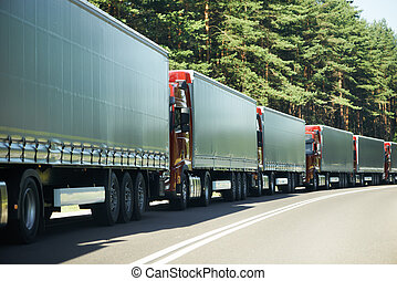 Lorry trucks cars in traffic jam at border zone custom