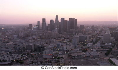 Flying thru downtown Los Angeles at sunset.