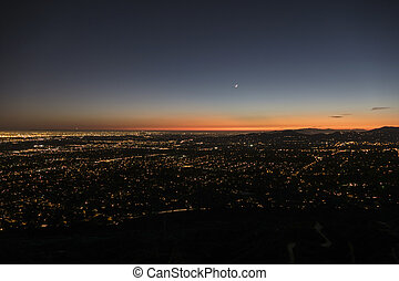 Los Angeles and Pasadena dusk night mountain top view.