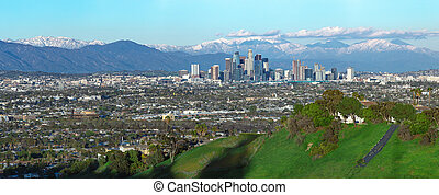 Los Angeles City Scape With Snowy Mountains - Panoramic view...
