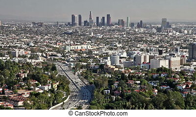 Los Angeles city view with traffic on freeway
