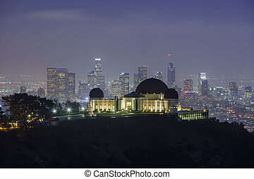 Los Angeles downtown nightscape with Griffin Observatory,...