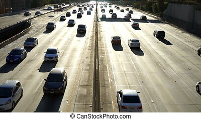 Los Angeles Freeway Commuters in Automobiles Backlit Highway...