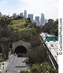 The Pasadena or Harbor Freeway leading into downtown Los Angele on a hazy day.