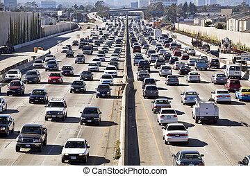 Cars and trucks choke the San Diego Freeway in both directions during the afternoon rush hour in Los Angeles near an interchange