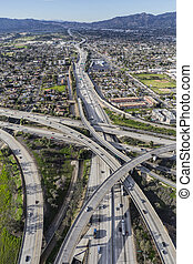 Aerial view north on the Golden State 5 Freeway on the San Fernando Valley area of Los Angeles, California.