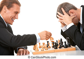 Image of businessmen playing in chess