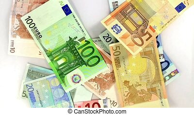 Losing Money - Expenses. Reverse motion of Euro banknotes...