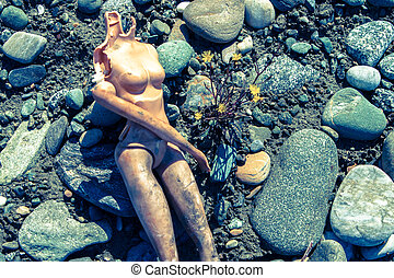Losing my head - Headless doll on beach with wildflower and...