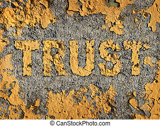 Losing trust and deteriorating integrity as a business concept represented by old fading yellow cracked paint on a rough cement wall showing the business metaphor of lost morality and illegal financial bank and stocks transactions.