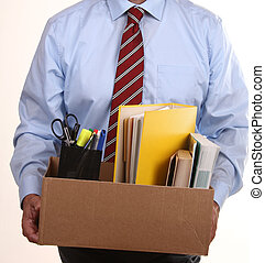 losing your job - businessman carries his belongings after ...