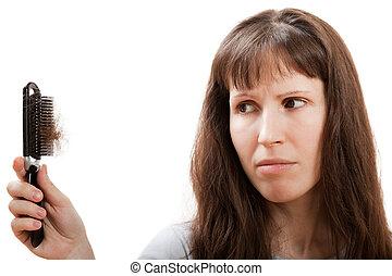 Loss hair comb in women hand - Balding problem women hand...