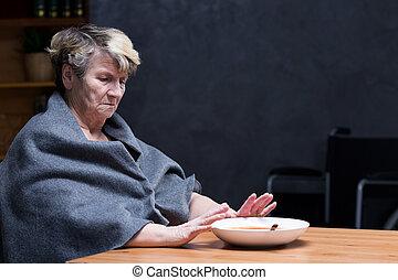 Loss of appetite - Depressed appetite- elderly woman ...