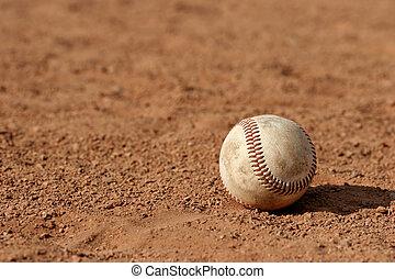 lost baseball - macro of a baseball lost on the field