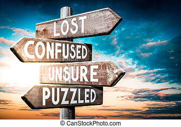 Lost, confused, unsure, puzzled - wooden signpost, roadsign with four arrows