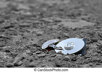 lost data - lost hard drive, partially buried in the ground....