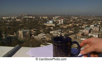 Lost documents - A man cleans a mug of tea with the...