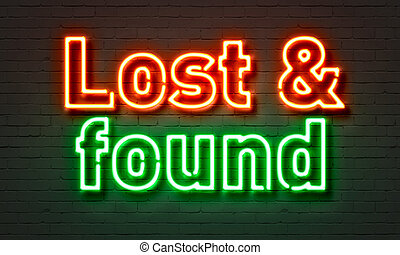 Lost & found neon sign on brick wall background. - Lost &...