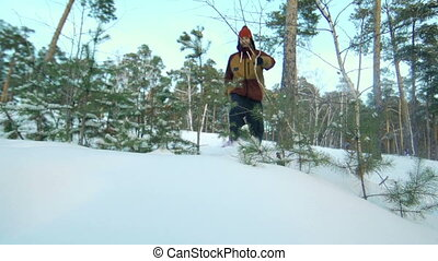 Lost in Action - Low angle of man pulling toboggan through...