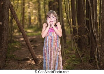 Lost little girl in the forest.