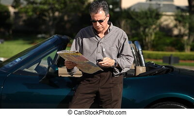 lost man map - A lost man looking at a map calls someone on...