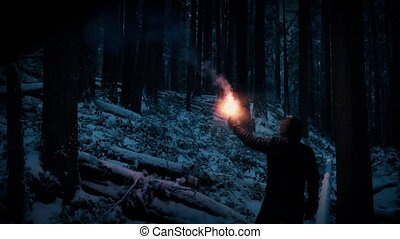 Lost Man Walking With Flare In Snowy Wilderness