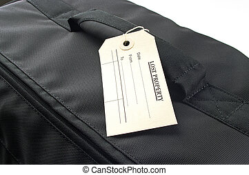 lost property tag on black bag - a lost property lable on...