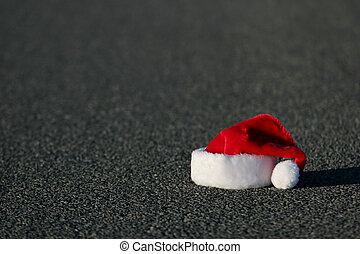 lost santa hat on the highway. horizontal version with shallow dof.