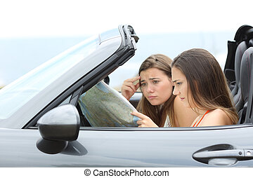 Lost tourists searching destination in a car