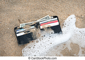Lost wallet - A lost wallet in the surf zone at the beach.