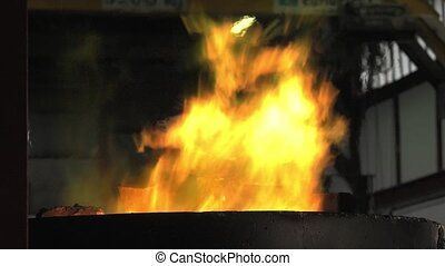 Lost wax bronze casting - view of the flames springing from...