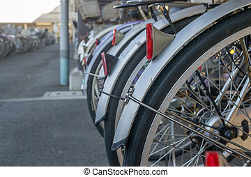Lot of Bicycles parking at train station in Japan.