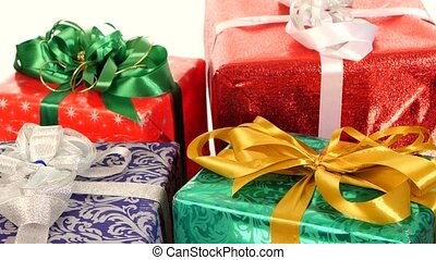 Lot of boxes, gifts tied with ribbons and bows isolated on white background, rotation