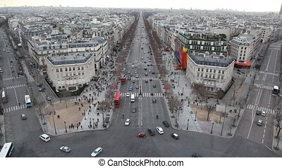 lot of cars and pedestrains on street of Paris, view from Triumphal Arch