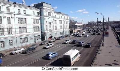 Lot of cars ride to Crimean Bridge in Moscow at sunny winter...