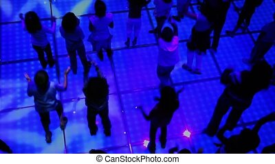 Lot of children dance at discotheque, view from above