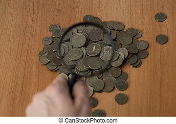 Lot of coins, view through a magnifying glass