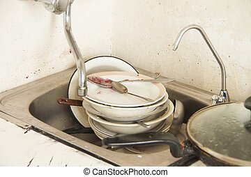 Lot of dirty dishes in the old kitchen