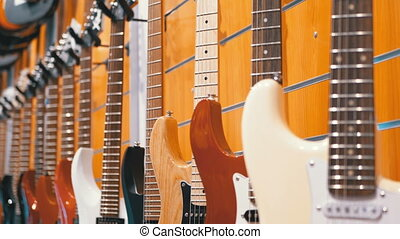 Lot of Electric Guitars Hanging in a Music Store. Shop...