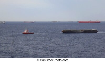 lot of freighter ships on seaway near moorage