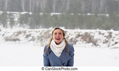 Lot Of Fun - Excited girl having a lot of fun throwing snow...