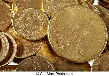 Close up of a stock of Gold french and american coins