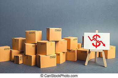Lot of goods cardboard boxes and easel with a red dollar down arrow. Decline trade production rates, decreased sales. Low export. Economic reduced, industry degradation. Marketing, price reduction.