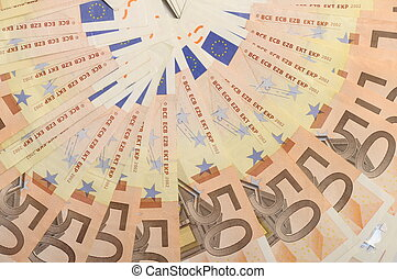 Lot of money fifty euros banknotes for background arranged in a circle