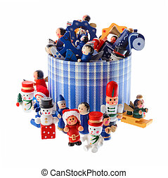 Lot of multicolored Christmas decorations in a blue striped round box