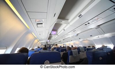 lot of people in cabin of flying aircraft