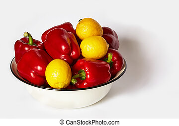 Lot of pepper and lemons lie in a basin