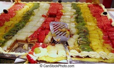 Lot of pieces of fruit cake, close up view in motion
