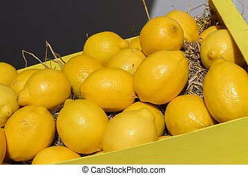 lemons in wooden crate