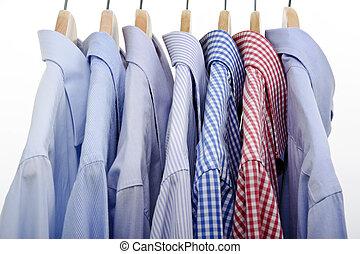 lot of shirts hanging on white background